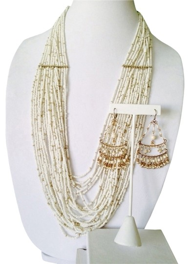 Preload https://item3.tradesy.com/images/whitegold-2-piece-set-and-seedbead-necklace-and-earrings-2170942-0-0.jpg?width=440&height=440