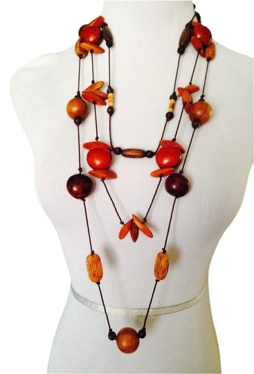 Preload https://img-static.tradesy.com/item/2172954/shades-of-brown-nuts-3-strand-wood-and-ivory-cord-necklace-0-0-540-540.jpg