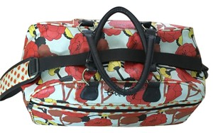 Billabong Unusual Weekend Mod orange flower graphic on ecru with brown leatherette Travel Bag