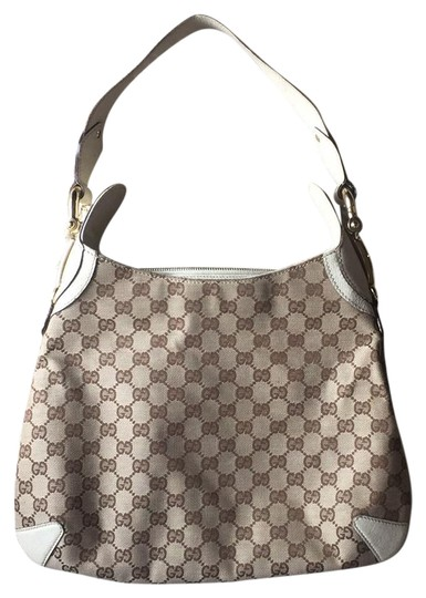 Preload https://img-static.tradesy.com/item/21747138/gucci-beige-canvas-and-leather-hobo-bag-0-1-540-540.jpg