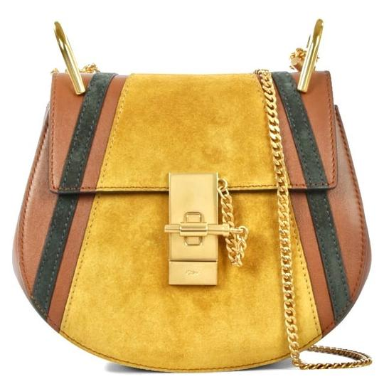 Preload https://img-static.tradesy.com/item/21764436/chloe-drew-mini-patchwork-saddle-mustard-leather-and-suede-cross-body-bag-0-4-540-540.jpg