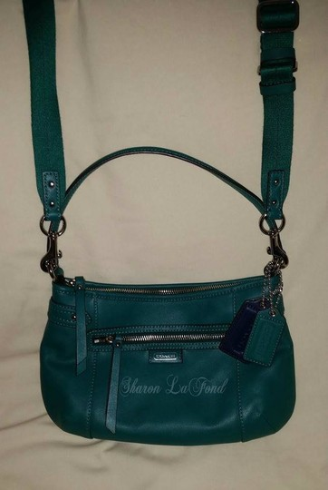 Coach Daily Leather Pockets Hangtage Cross Body Bag