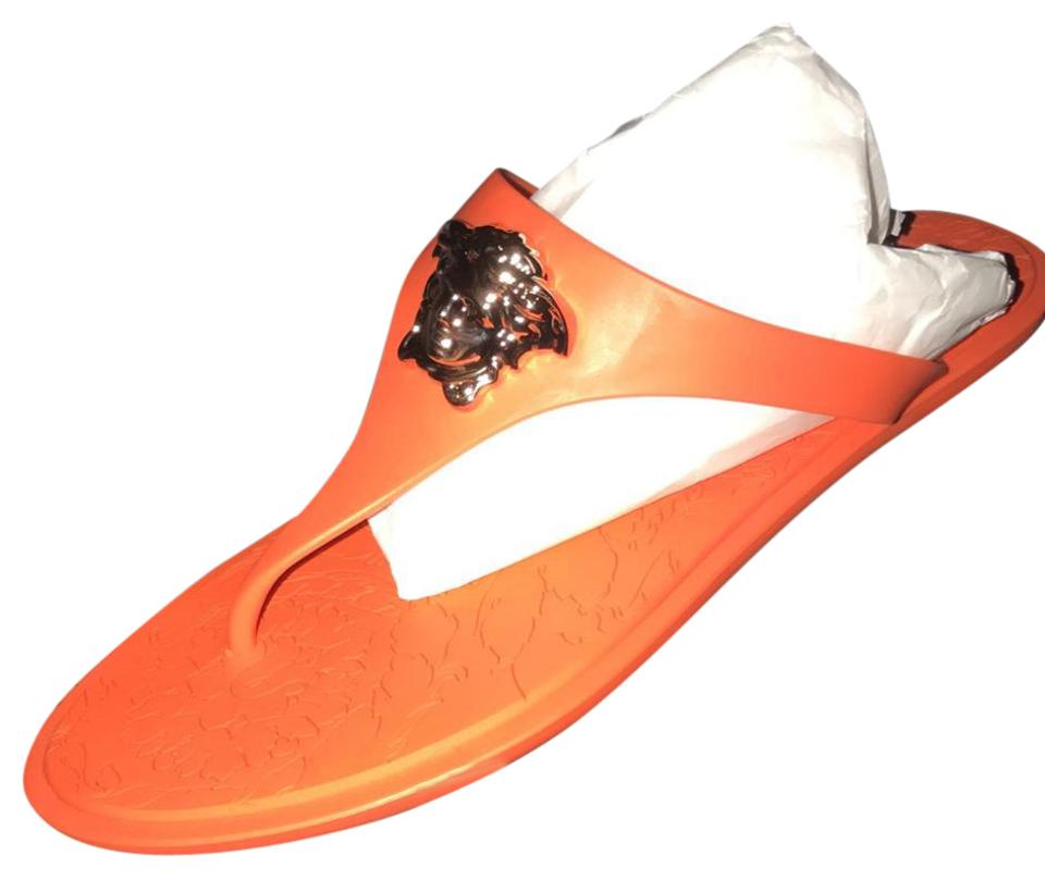 71a8a6aff9a5 Versace Orange Medusa Rubber Sandals Size US 6.5 Regular (M