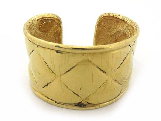 Preload https://item3.tradesy.com/images/chanel-gold-4418-lm-st-quilted-cuff-220565-bracelet-21773267-0-1.jpg?width=440&height=440