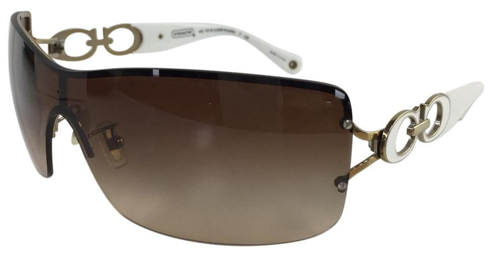 f452e4bae2 Coach Brand New Oversized Rimless Sunglasses HC7018 9118 13 Noelle Gold  White On Temple Gradient ...