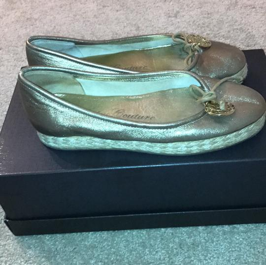 Juicy Couture gold Flats