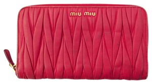 Miu Miu matelasse gathered zippy wallet