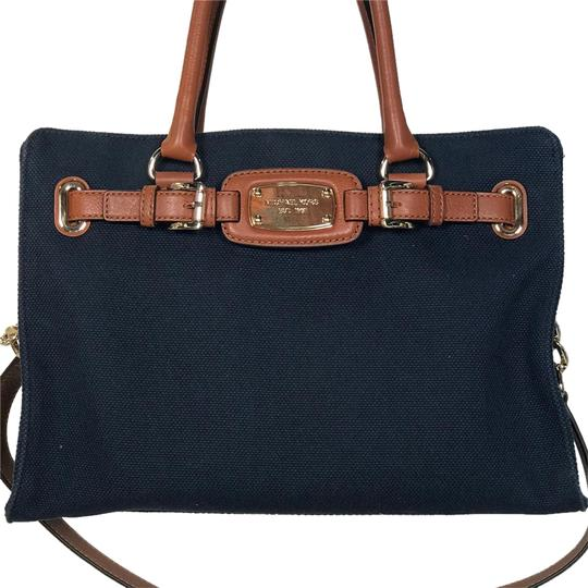 Preload https://img-static.tradesy.com/item/21821905/michael-kors-navy-leather-and-canvas-satchel-0-1-540-540.jpg
