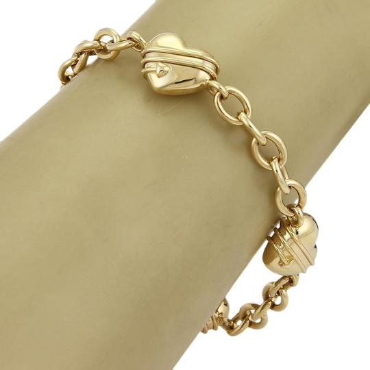 Preload https://img-static.tradesy.com/item/21824964/tiffany-and-co-20431-cupid-4-heart-charms-oval-link-18k-yellow-gold-bracelet-0-2-540-540.jpg