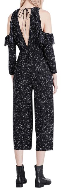 Preload https://img-static.tradesy.com/item/21827311/topshop-black-star-print-ruffled-crepe-romperjumpsuit-0-1-650-650.jpg