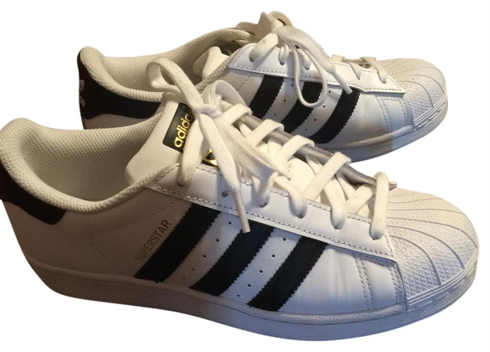 on sale 2f3a1 ff2dc adidas White and Black Stripe Sneakers Size US