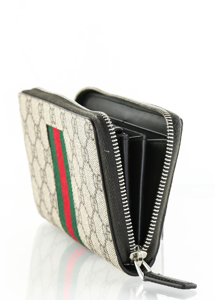 5e2504c47a1fa Gucci   Gucci 9791 Web GG Supreme zip around wallet Image 9. 12345678910