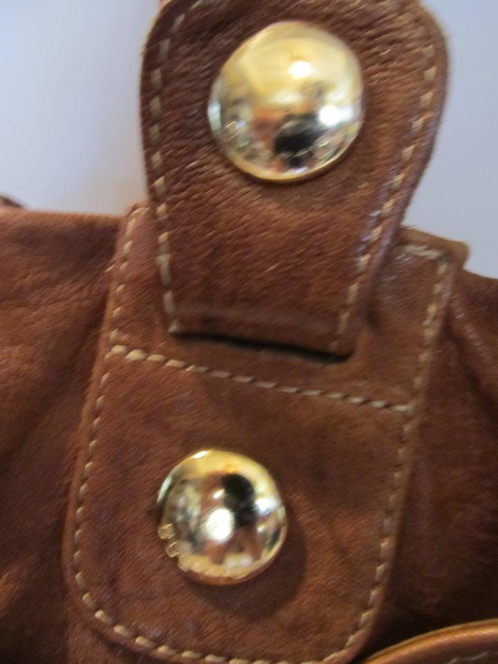 4e59b9f6bc27 Gustto Studded Leather Tote in Brown. 1234567