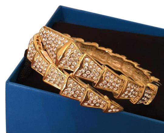 Preload https://img-static.tradesy.com/item/21848169/real-collectibles-by-adrienne-gold-tone-bangle-bracelet-0-1-540-540.jpg