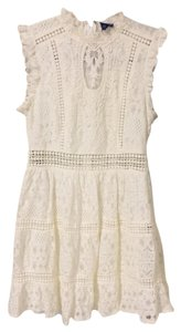 Beauty & the Beach short dress White on Tradesy