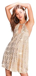 Urban Outfitters short dress gold on Tradesy