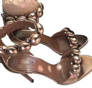 ALAÏA Metallic rose Platforms