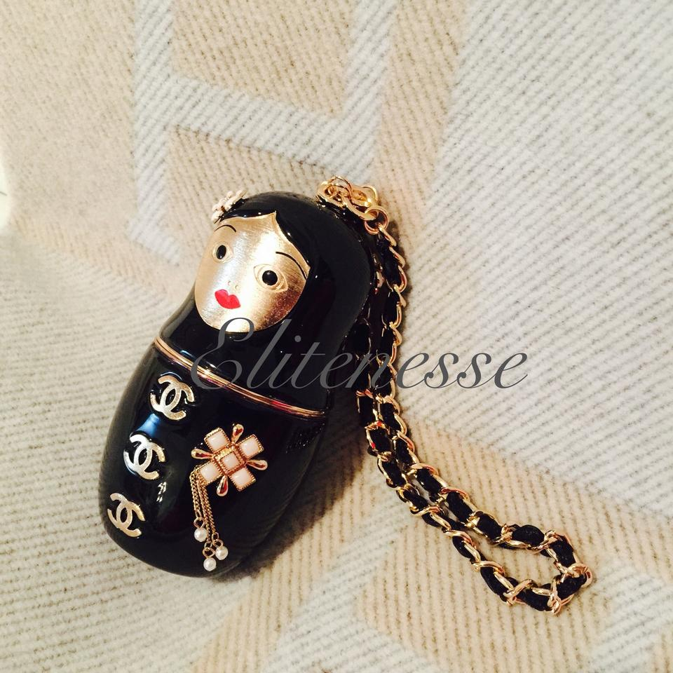 260d8626ddc3d2 Chanel Matryoshka Black & Gold Enamel and Metal Clutch - Tradesy