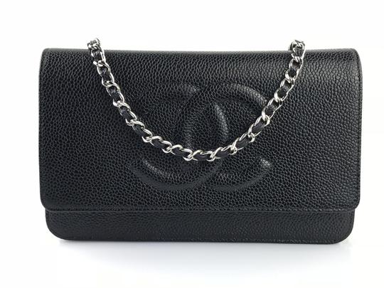 Preload https://item4.tradesy.com/images/chanel-wallet-on-chain-caviar-black-leather-cross-body-bag-2186378-0-1.jpg?width=440&height=440