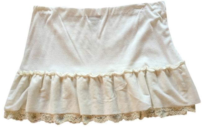 Preload https://item2.tradesy.com/images/wet-seal-cream-lace-trim-miniskirt-size-8-m-29-30-2186821-0-0.jpg?width=400&height=650