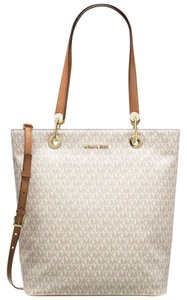 9ae70ee5adc885 Added to Shopping Bag. Michael Kors Tote in Vanilla. Michael Kors Signature Raven  Large ...