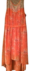 Kirra short dress Orange Cream. Hi-low Chiffon Lace on Tradesy
