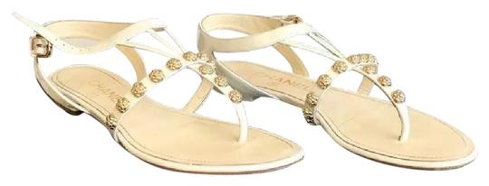 Preload https://img-static.tradesy.com/item/21915482/chanel-white-and-gold-camellia-thongs-sandals-size-eu-37-approx-us-7-regular-m-b-0-1-540-540.jpg