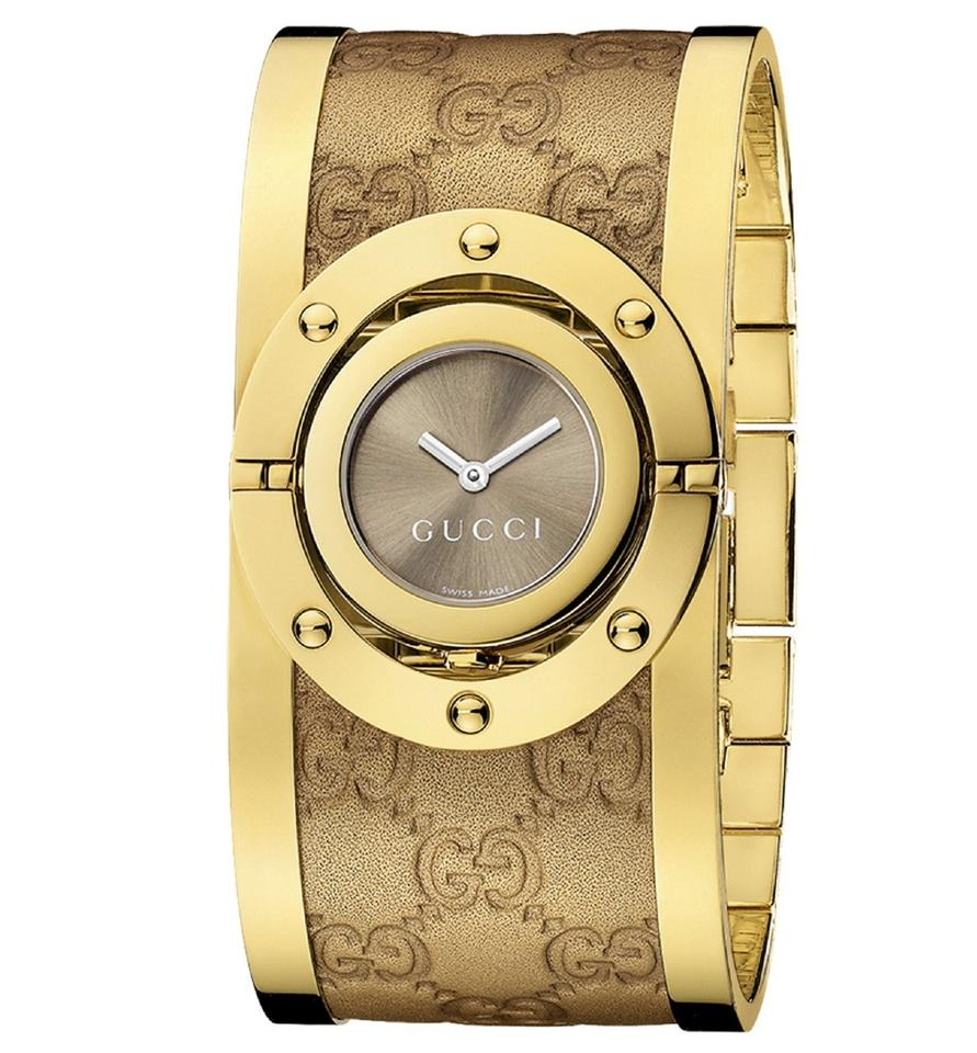 4af840e11c1 Gucci Twirl Brown Dial Gold-tone Steel with Leather Bracelet Ladies Watch  Image 0