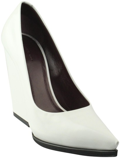 Preload https://item5.tradesy.com/images/celine-white-leather-pointed-toe-pumps-size-us-75-regular-m-b-21938494-0-2.jpg?width=440&height=440