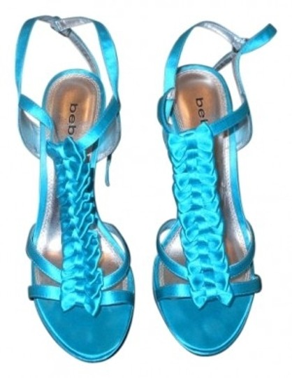 Preload https://item2.tradesy.com/images/bebe-blue-name-jenny-style-157485-pumps-size-us-9-regular-m-b-21941-0-0.jpg?width=440&height=440
