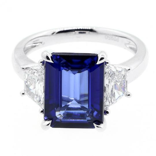 Blue 1.08 Cts Trapez Cut with 5.38 Cts Jadore Emerald Cut Set Engagement Ring Image 1