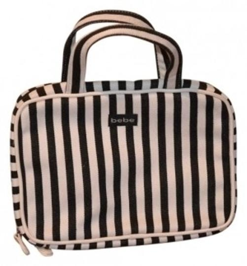 Preload https://item5.tradesy.com/images/bebe-make-up-like-new-never-use-black-and-white-weekendtravel-bag-21969-0-0.jpg?width=440&height=440