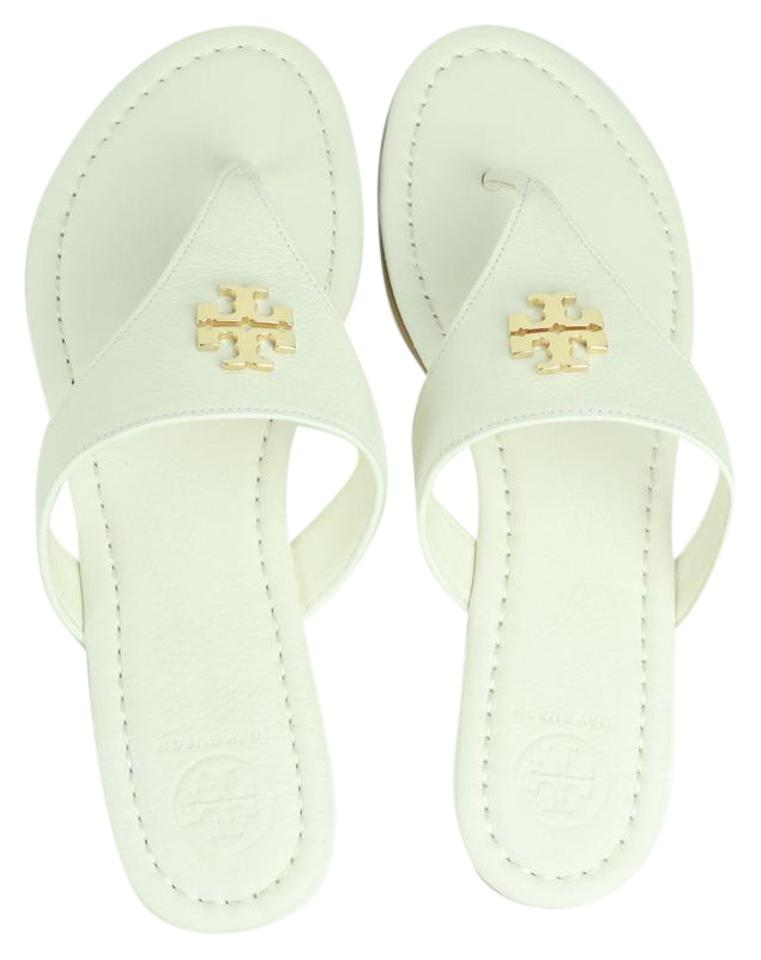 6ef1df44c501c Tory Burch Ivory ( White )   Gold Laura Flat Thong   Tumbled Leather Sandals
