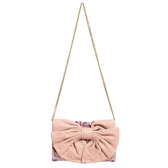 Preload https://img-static.tradesy.com/item/21982537/red-valentino-women-s-decorated-clutch-pink-50-leather-50-canvas-shoulder-bag-0-0-540-540.jpg