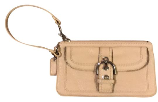 Preload https://img-static.tradesy.com/item/21985721/coach-buckle-front-cream-leather-wristlet-0-1-540-540.jpg