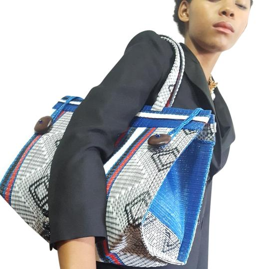Preload https://img-static.tradesy.com/item/21988407/woven-never-full-multi-black-red-turquoise-white-recycled-materials-tote-0-3-540-540.jpg
