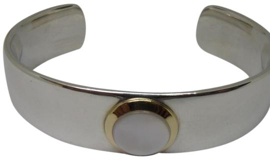Preload https://img-static.tradesy.com/item/21988958/tiffany-and-co-silver-gold-white-mother-of-pearl-cuff-in-18k-yellow-sterling-bracelet-0-1-540-540.jpg