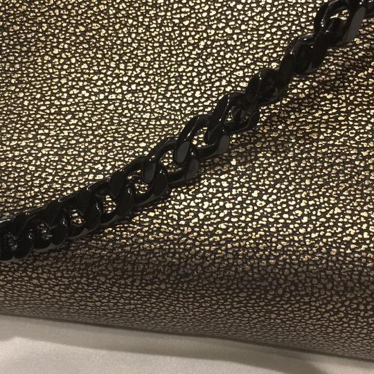 Coach gold / black metallic Clutch
