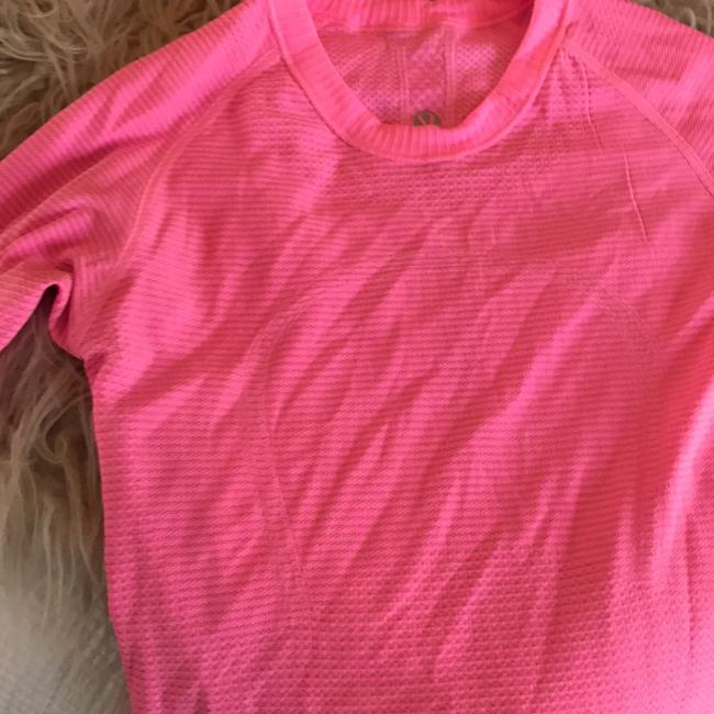 Preload https://item1.tradesy.com/images/lululemon-pink-activewear-top-size-4-s-22000505-0-0.jpg?width=400&height=650
