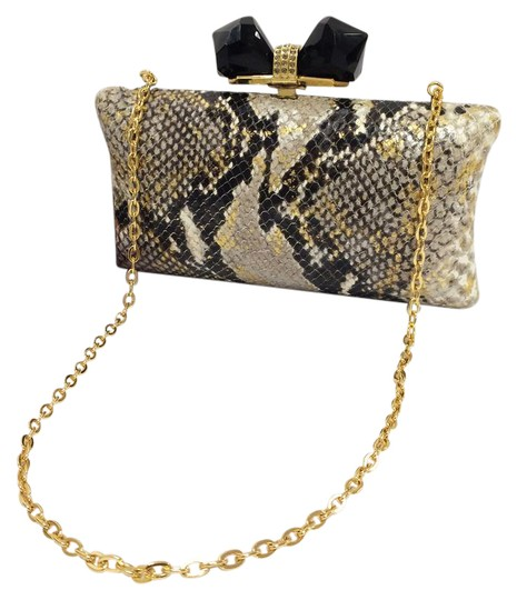 Preload https://item1.tradesy.com/images/judith-leiber-overture-vanessa-concave-sided-multicolor-python-embossed-leather-clutch-22000615-0-1.jpg?width=440&height=440