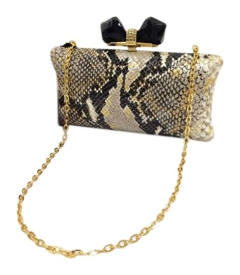 Preload https://img-static.tradesy.com/item/22000615/judith-leiber-overture-vanessa-concave-sided-multicolor-python-embossed-leather-clutch-0-3-540-540.jpg
