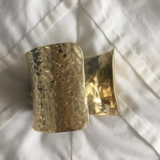 Unknown Designer gold cuff bracelet with ruby colored stone