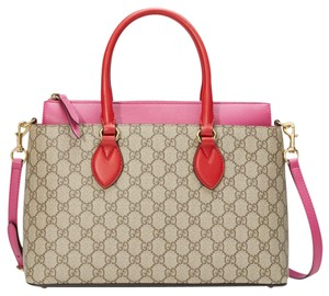 a22f59ee2a3573 Added to Shopping Bag. Gucci Tote in Beige with pink and Red accents. Gucci  Gg Supreme Leather Handle Strap ...