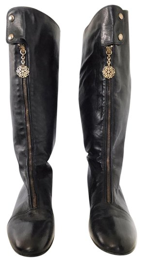 Preload https://item2.tradesy.com/images/black-leather-zipper-pull-wedge-bootsbooties-size-us-9-narrow-aa-n-22001641-0-1.jpg?width=440&height=440