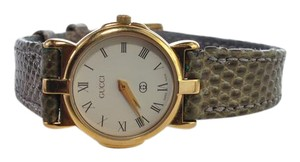 Gucci Ladies' gold plated and stainless steel 33mm Gucci watch