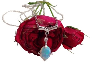 Other 14k White Gold Fiery Opal And Diamond Necklace.