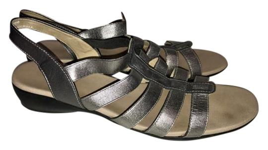 Preload https://img-static.tradesy.com/item/22018153/munro-silver-leather-sandals-size-us-95-regular-m-b-0-1-540-540.jpg