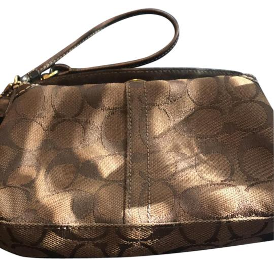 Preload https://img-static.tradesy.com/item/22018344/coach-fabric-brown-canvas-and-leather-wristlet-0-1-540-540.jpg
