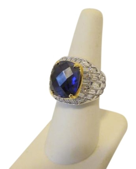Preload https://img-static.tradesy.com/item/22020378/real-collectibles-by-adrienne-silvertone-1486ctw-cz-tanzanite-color-7-ring-0-6-540-540.jpg