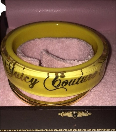 Preload https://item2.tradesy.com/images/juicy-couture-yellow-gold-yellowgold-bangles-2202221-0-0.jpg?width=440&height=440